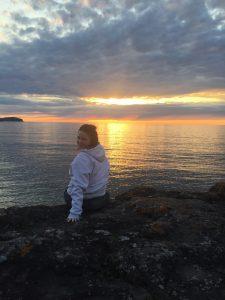 Dani overlooking Lake Superior at sunrise.